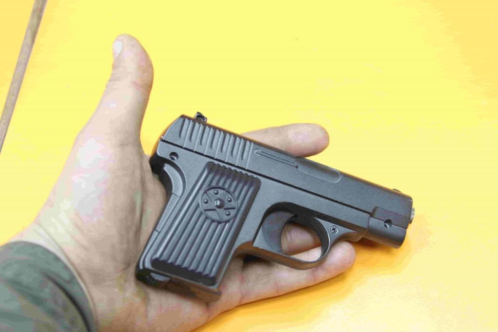 Минитюрный спринговый пистолет изображение